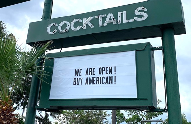 """The sign's new message, after having earlier read """"F..K CHINA WE ARE OPEN! BUY AMERICAN!"""" - PHOTO BY CAROLINE SILVA"""