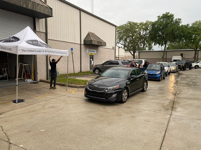 Cars lined up outside Buy & Sell Fitness for contactless sales - SPONSORED CONTENT