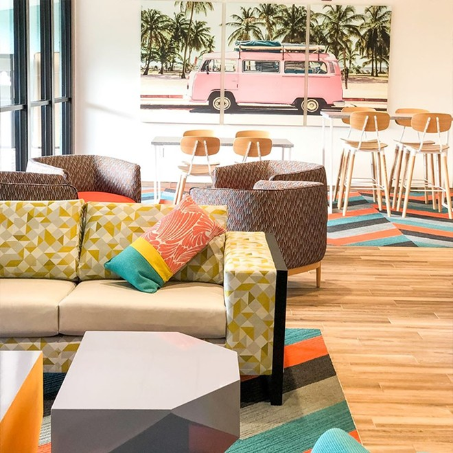 The lobby of Beachside Hotel and Suites embraces Cocoa Beach's rich surf history - IMAGE VIA BEACHSIDE HOTEL & SUITES
