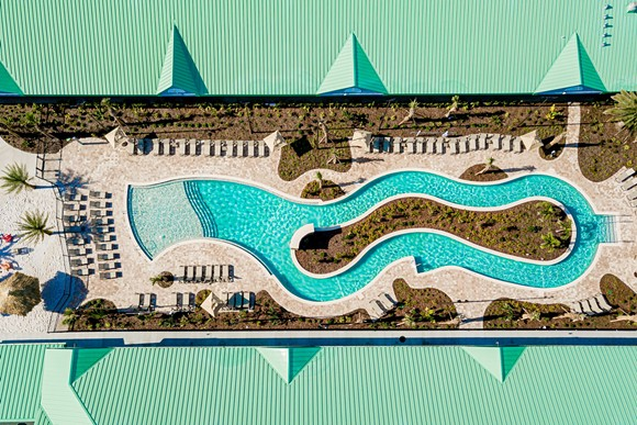 The newly installed beach-inspired lazy river pool deck at the Beachside Hotel & Suites - IMAGE VIA BEACHSIDE HOTEL & SUITES