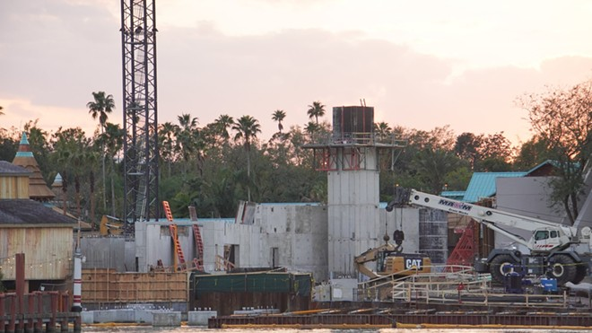 A tower similar to the one in Jurassic World's Raptor Paddocks can be seen in the middle of the coaster construction site. - IMAGE VIA BIORECONSTRUCT | TWITTER