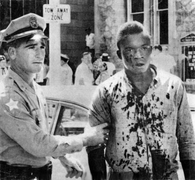 Charlie Griffin, a victim of the violence in Jacksonville on August 27, 1960, is detained by police. - PHOTO VIA FLORIDA STATE ARCHIVES