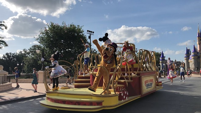 Minnie and Pluto decline to mask. - PHOTO BY SETH KUBERSKY
