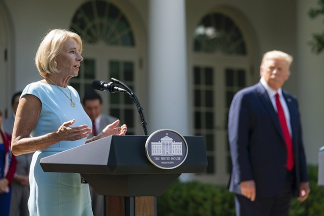 BETSY DEVOS AND DONALD TRUMP JULY 9, 2020 - (OFFICIAL WHITE HOUSE PHOTO BY TIA DUFOUR)