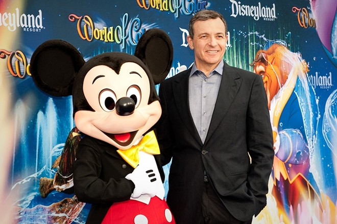 Mickey Mouse and Bob Iger on the red carpet. Iger stepped down as Disney CEO in February. - PHOTO VIA WIKIMEDIA COMMONS