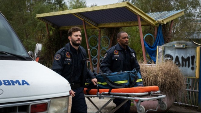 "Paramedics Dennis, left, and Steve take care of New Orleans' wounded, and each other, but they aren't prepared for where ""Synchronic"" will take them. - WELL GO USA ENTERTAINMENT"
