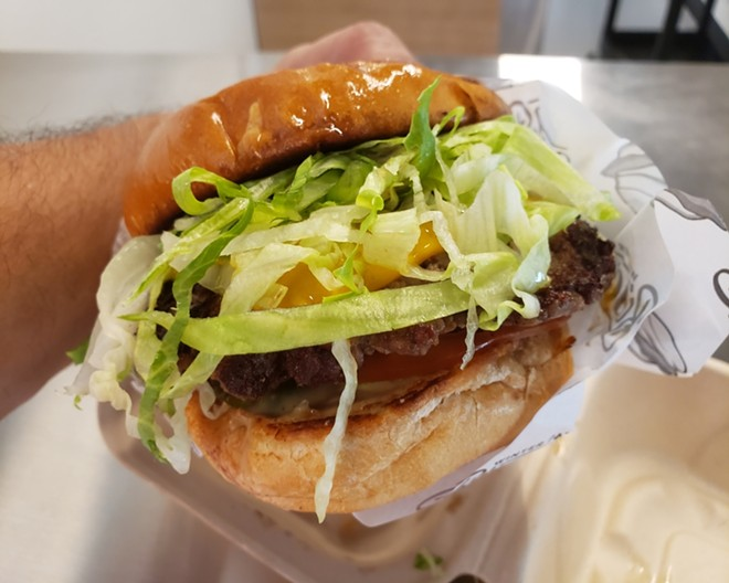 Impossible Burger w/vegan American cheese, lettuce, tomato, pickles, WPBC sauce, toasted potato bun - PHOTO BY FAIYAZ KARA