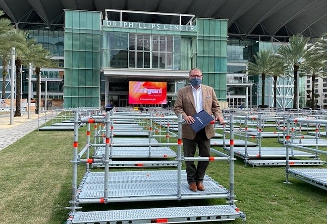 Mayor Dyer tries out a Frontyard Festival seating pod - PHOTO COURTESY ORLANDO MAYOR BUDDY DYER/FACEBOOK