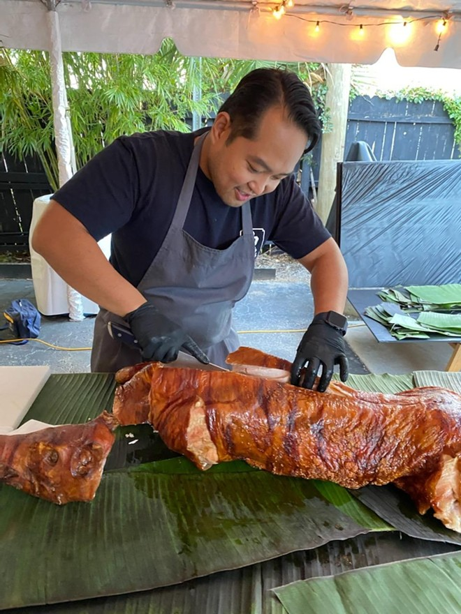 Lorder Lalicon shows off his pig-cutting skills - PHOTO BY JAMI BAILEY