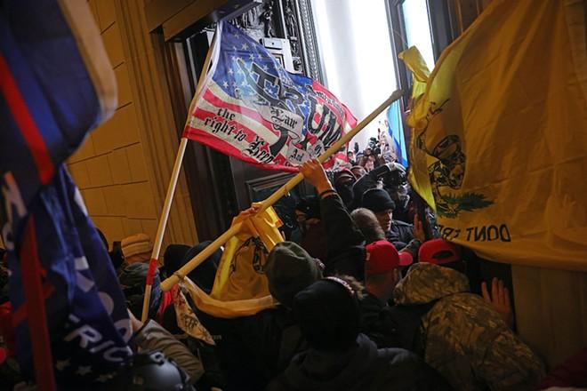 Protesters supporting Donald Trump break into the U.S. Capitol, Washington, D.C., U.S., Jan. 6, 2021. - ALEX GAKOS / SHUTTERSTOCK.COM