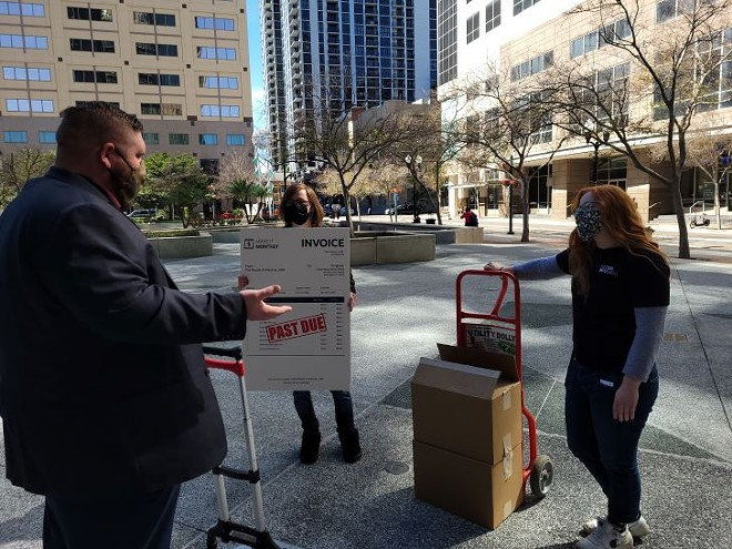 Activists deliver thousands of 'past-due' invoices to Sen. Marco Rubio's Orlando office staffers - SIERRA WILLIAMS