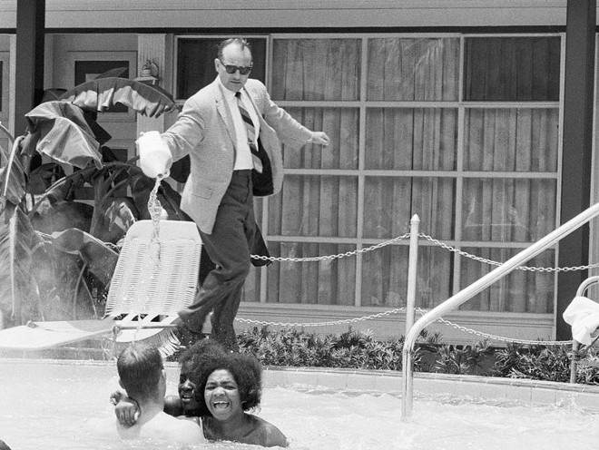 "The owner of the Monson Motor Lodge in St. Augustine attempting to enforce his ""whites only"" pool rules in 1964."