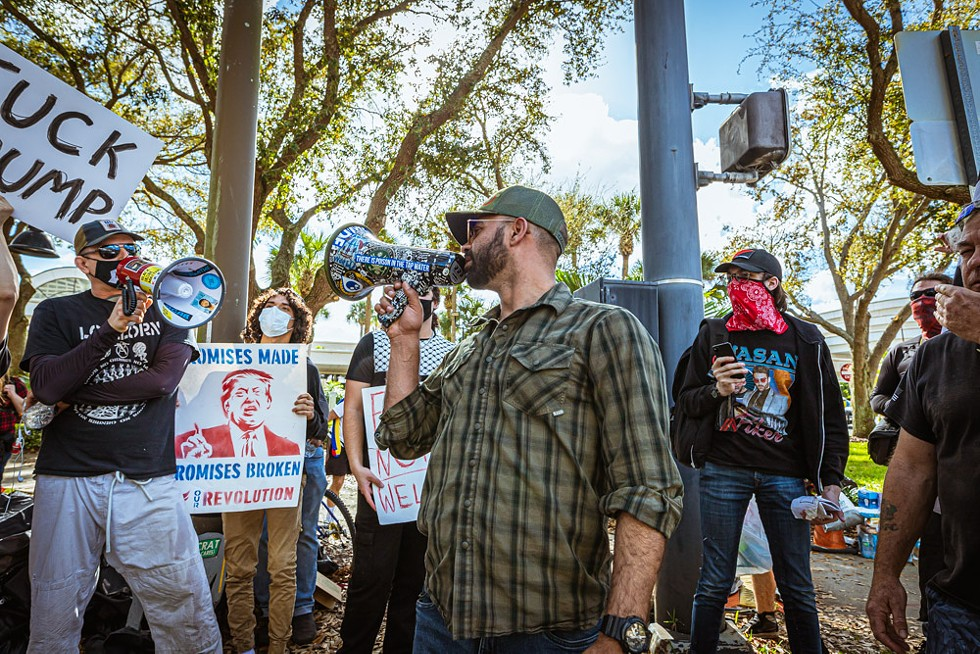 Proud Boy Enrique Tarrio locks (bull)horns with an anti-fascist protester. - PHOTO BY DAVE DECKER