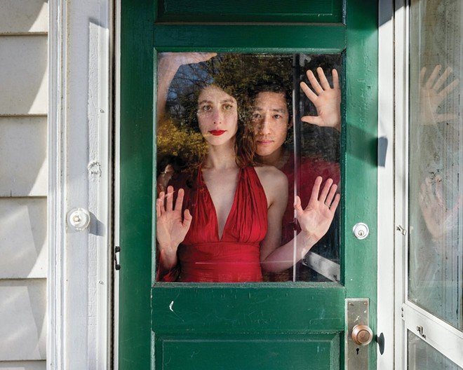 'Mia and Jun, Allston Massachusetts, 2020.'From 'Rania Matar: On Either Side of the Window, Portraits During COVID-19,' at Cornell Fine Arts Museum through May 9, 2021 - PHOTOGRAPH COPYRIGHT RANIA MATAR, ARCHIVAL PIGMENT PRINT ON BARYTA PAPER, IMAGE COURTESY OF THE ARTIST