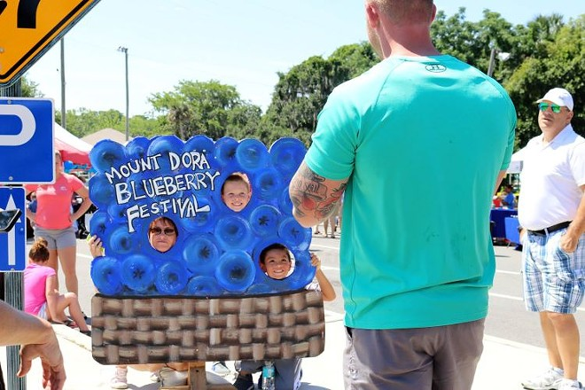 Festival goers at the 2018 Mount Dora Blueberry Festival take pictures in the blueberry sign. - PHOTO VIA MOUNT DORA BLUEBERRY FESTIVAL/FACEBOOK