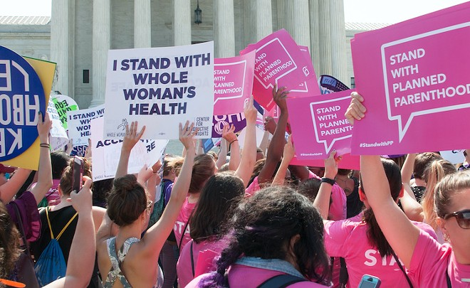 Pro-choice activists await the SCOTUS ruling on abortion access in front of the Supreme Court in Washington, D.C. - PHOTO BY RENA SCHILD
