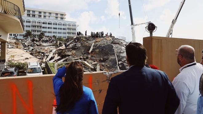 Florida Gov. Ron DeSantis looks at the rubble of the Champlain Towers collapse. - PHOTO VIA TWITTER/RON DESANTIS