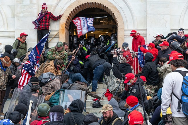 Rioters clash with police trying to enter Capitol building through the front doors (Jan. 6, 2021) - PHOTO BY LEV RADIN