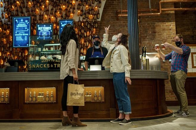 A butterbeer bar inside Harry Potter New York - IMAGE VIA HARRY POTTER NEW YORK | FACEBOOK