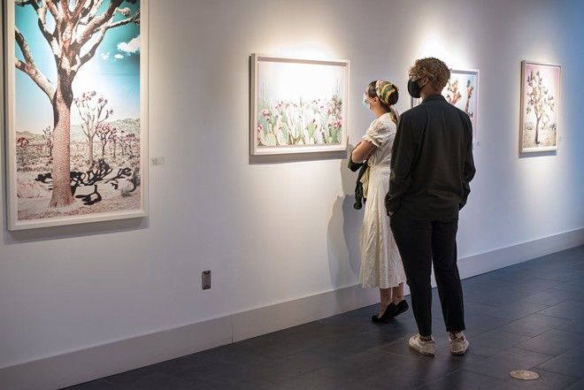 Attendees at Snap Orlando's 'Summer Hues' exhibit opening - ART BY KRISTIN HART. PHOTO BY EMILY JOURDAN FOR SNAP ORLANDO.
