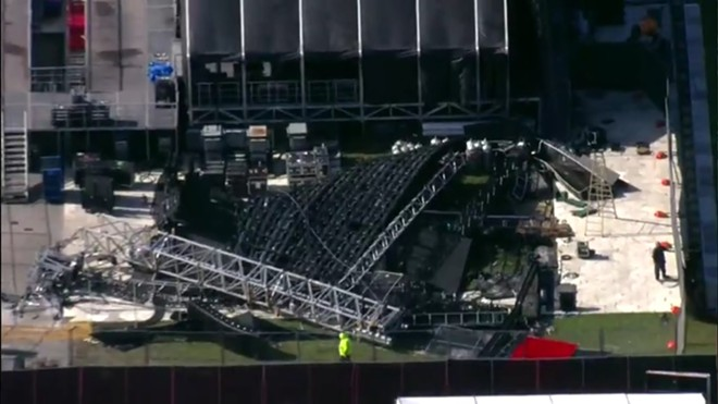 Footage from WSVN shows the collapsed screen on the Rolling Loud grounds. - SCREENSHOT VIA WSVN/TWITTER