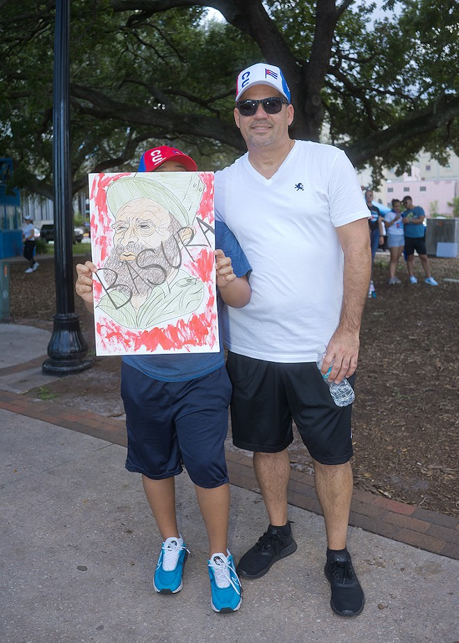 SOS Cuba protesters at Lake Eola Park on Saturday, July 18 - PHOTO BY CRUMMY GUMMY
