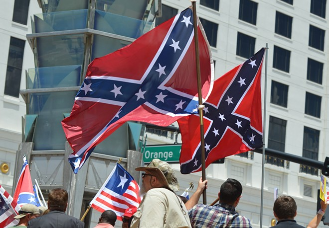 A protest by Confederate supporters outside Orlando City Hall in 2017. - PHOTO BY MONIVETTE CORDEIRO
