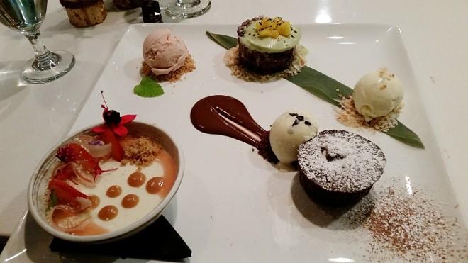 17. Dessert plate of mango sticky rice, flourless chocolate cake with dulce de leche filling, panna cotta with rhubarb gelee, coconut ice cream, strawberry-rhubarb ice cream