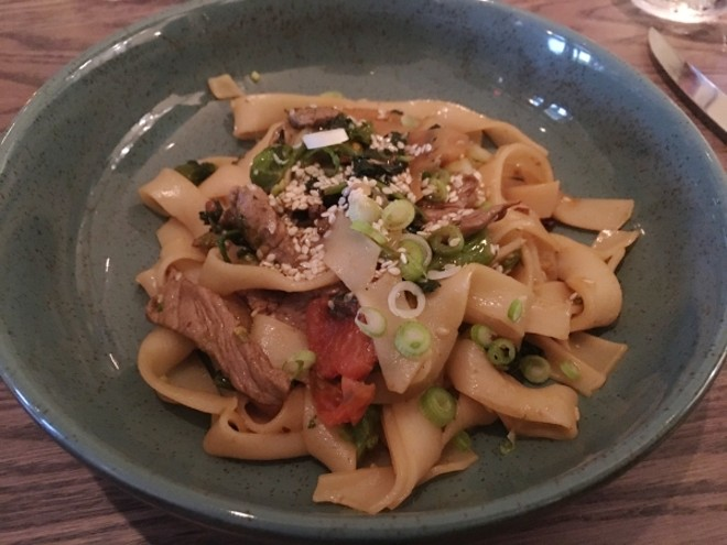 Szechuan manzo (beef) with rapini, romanesco, lotus root, and rice noodle tagliatelle