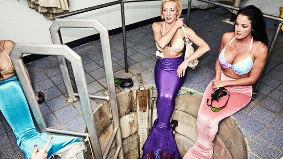 Stayce McConnell in purple, center, waiting to take the plunge with her mermaid colleagues. - PHOTO BY CHARLIE ENGMAN FOR VOGUE