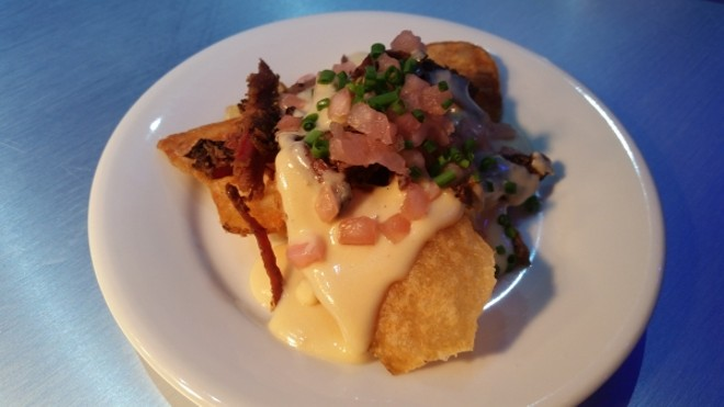 Smoked corned beef with warm crispy potatoes, pickled onions, and blonde ale beer fondue featuring BelGioioso Romano and America Grana cheeses (Flavors from Fire)