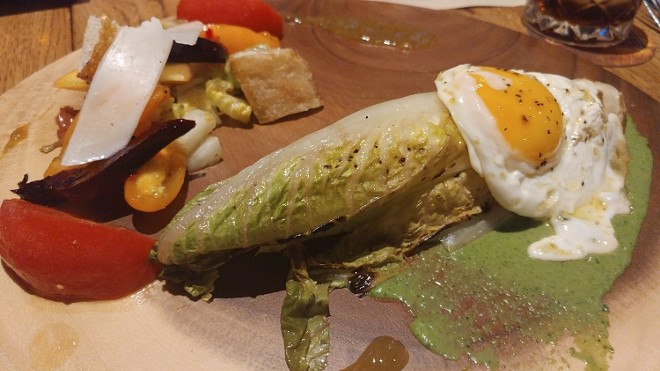 Grilled romaine, fried egg, chimichurri with a salad of roasted beets, stone fruit, manchego, cast-iron croutons
