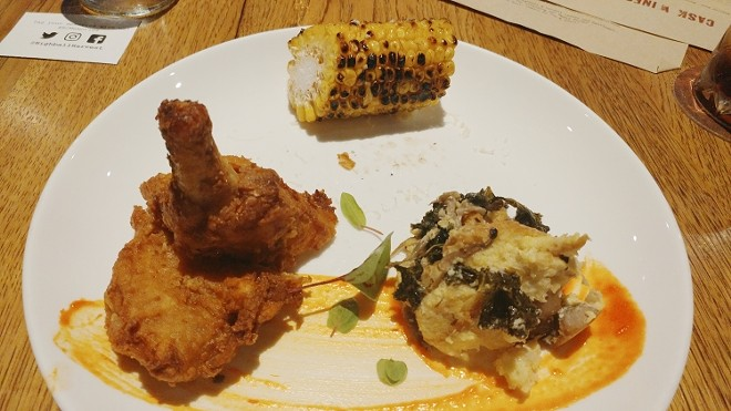Triple-dipped fried chicken, charred corn, savory mushroom-kale bread pudding, golden hot sauce