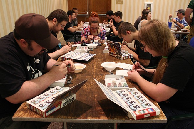 Painting miniatures at Dice Tower Con