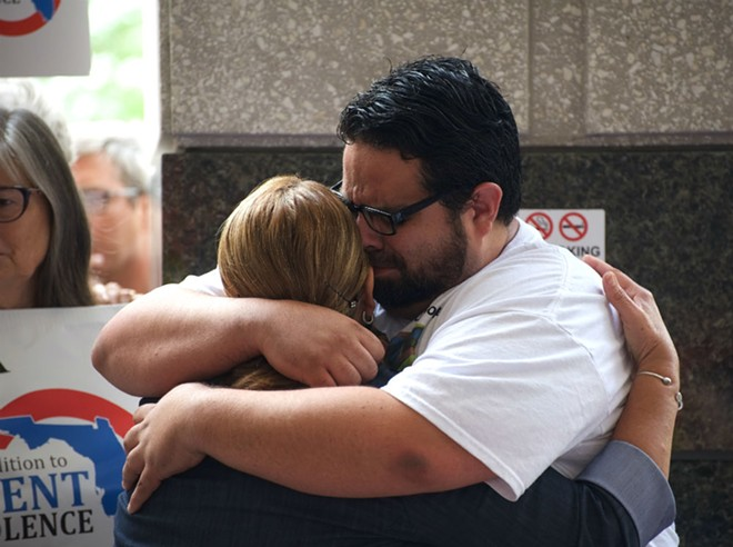 Brian Alvear hugs his mother, Mayra Alvear-Benabe - PHOTO BY MONIVETTE CORDEIRO