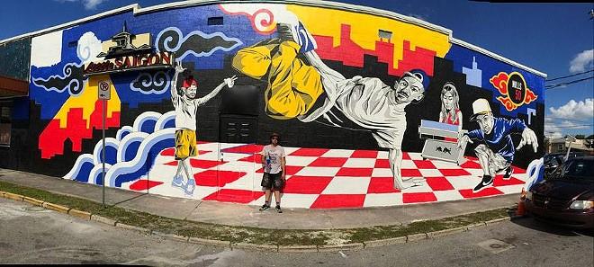 andrew_in_front_of_mural.jpg