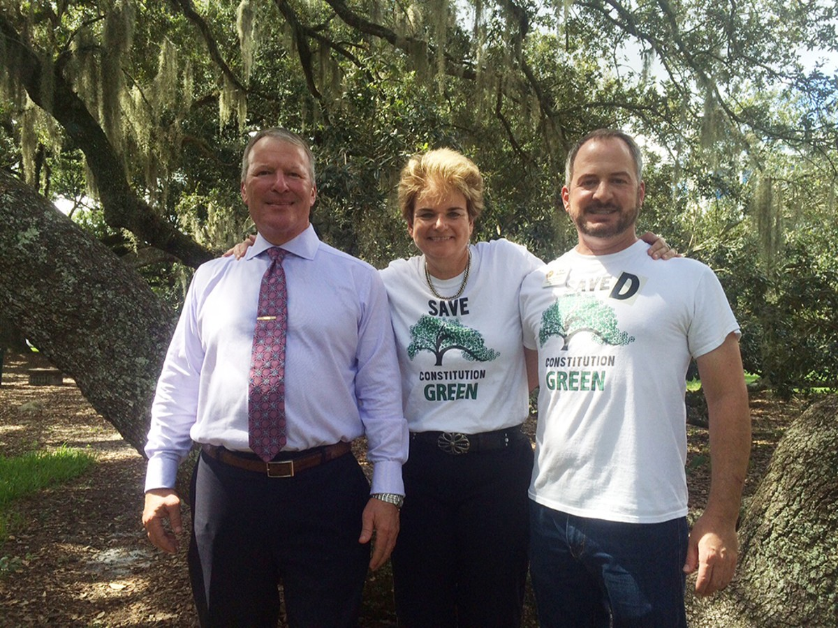 Mayor Buddy Dyer, City Commissioner Patty Sheehan and Soil and Water Conservation Supervisor 4 Eric Rollings