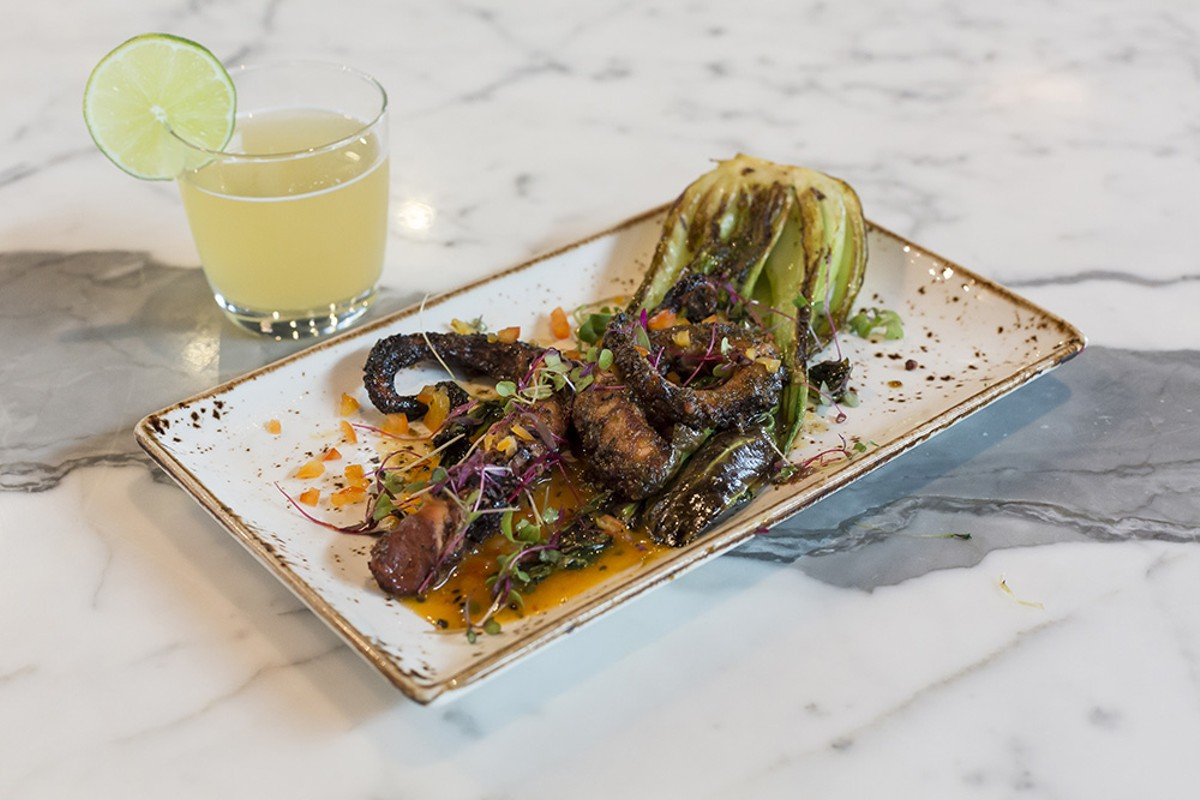Oak-charred octopus with chili-mango puree and soy-ginger-glazed bok choy at Canvas Restaurant