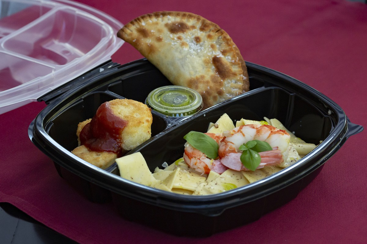 Vinia's 'bento box' includes freshly made beef and cheese empanadas, some of the best I've had anywhere.