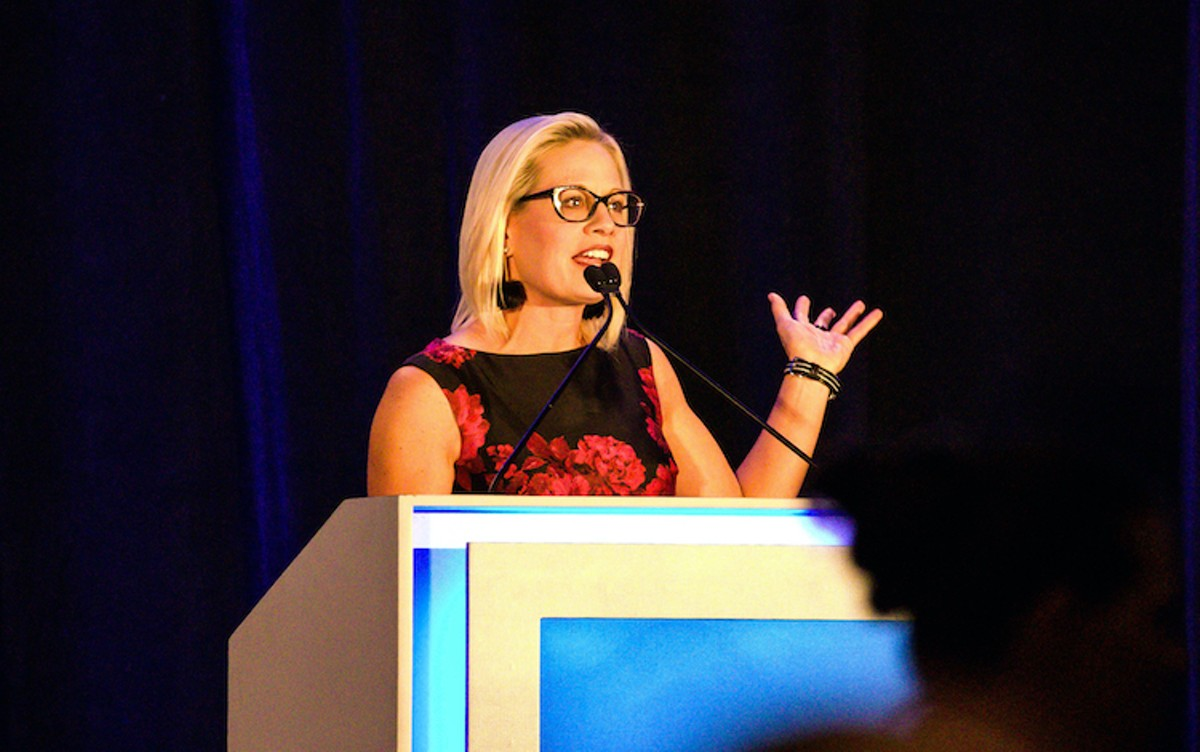 Sen. Kyrsten Sinema's ostentatious thumbs-down marred the passage of the American Rescue Plan.