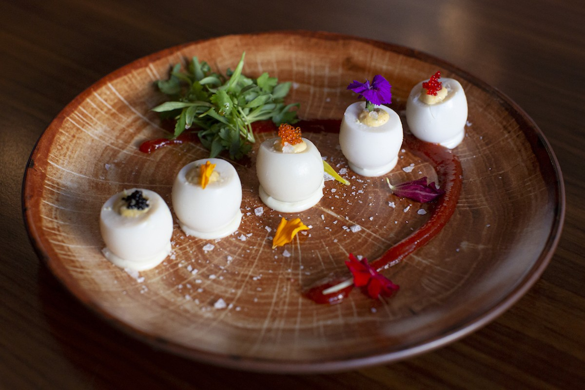 Sriracha deviled quail eggs with tobiko and truffle oil