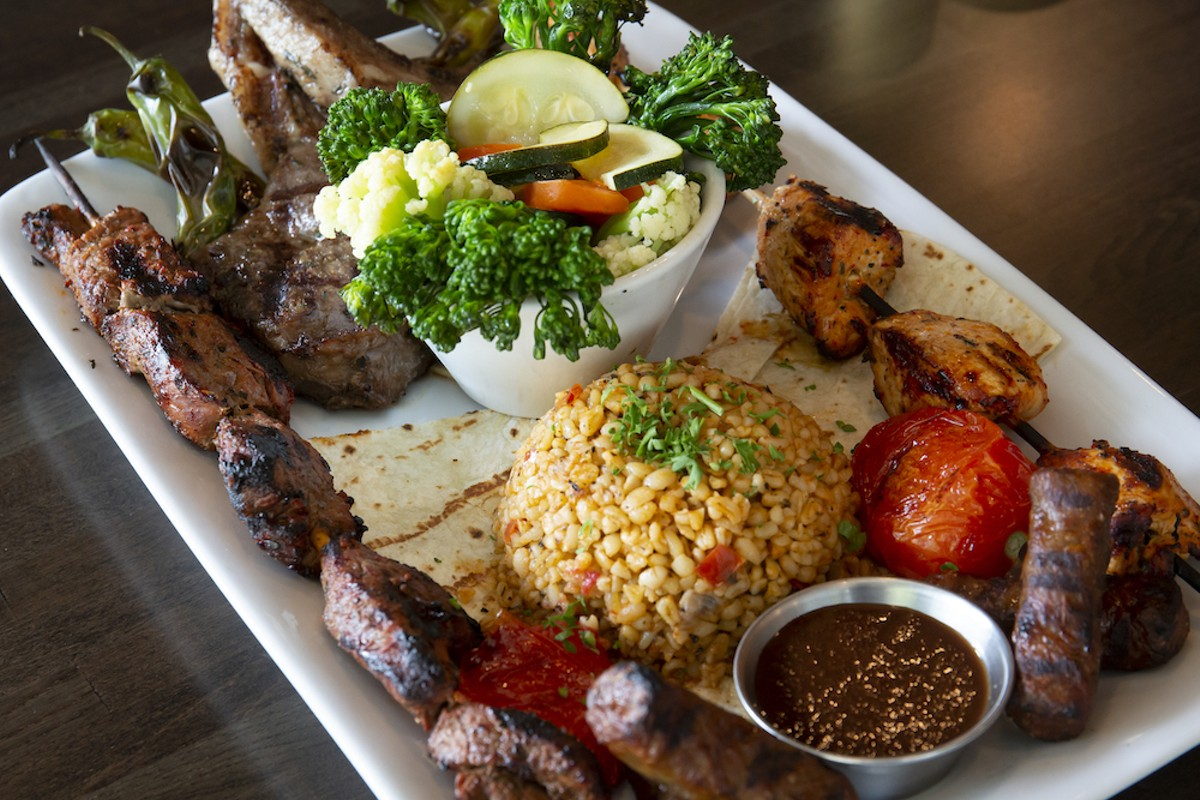 The Bridge Special Selection: Two gorgeous lamb chops, mini beef sausages, and brochettes of seasoned filet mignon and chicken served over lavash, with bulgur and seasonal vegetables