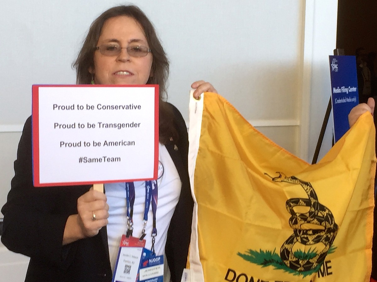 "Trans conservative Jennifer Williams carrying a ""Don't Tread on Me"" flag"