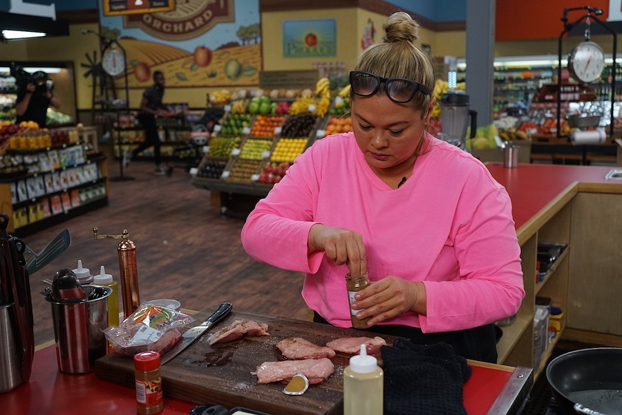 Pom spicing up some meat - PHOTO COURTESY FOOFDNETWORK