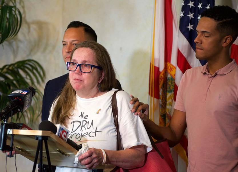Christine Leinonen, mother of Pulse victim Christopher Leinonen, is comforted by survivor Brandon Wolf. - PHOTO BY MONIVETTE CORDEIRO