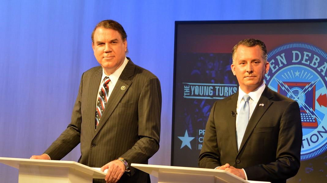 U.S. Reps. Alan Grayson, left, and David Jolly, right, at U.S. Senate Open Debate. - PHOTO BY MONIVETTE CORDEIRO