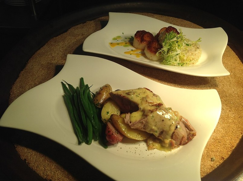 Chef Nathaniel Russell's seared diver scallops with leek pearl couscous and roasted pork tenderloin with bacon hollandaise - IMAGE VIA CAFE DE FRANCE ON YELP