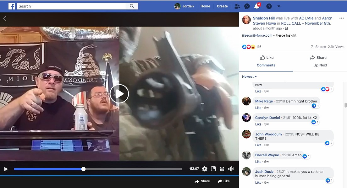 Chris Hill, then leader of the III% Security Force militia network, speaks on Facebook Live in June as Bill Hartwell points a rifle at the camera. - SCREENGRAB VIA JORDAN GREEN/TRIAD CITY BEAT