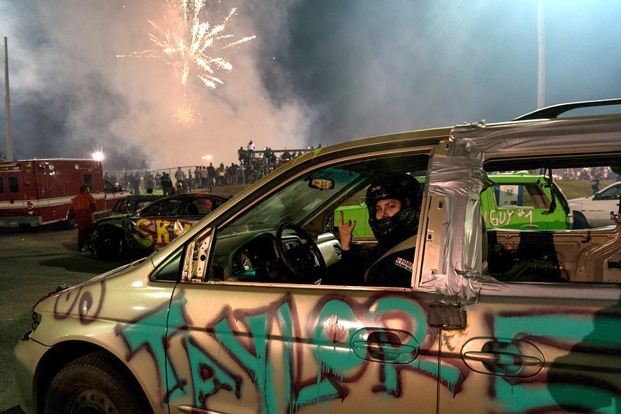 Taylor Bosak is ready for her upcoming minivan demo derby as the fireworks show ends. (Orlando Speedway, Nov. 29, 2019) - PHOTO BY CHRISTOPHER BALOGH