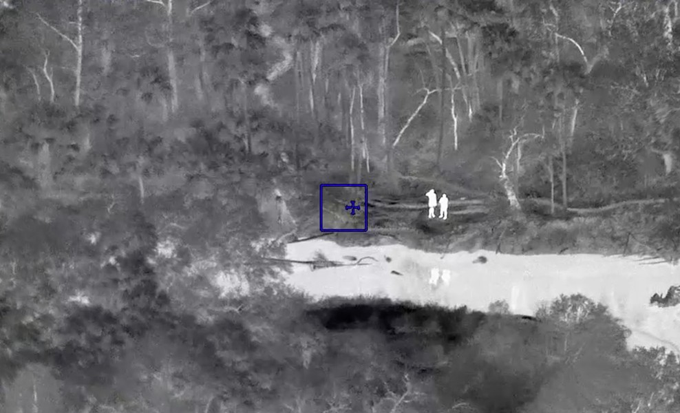 Two kayakers, whose inflatable boat was flipped over by an alligator on the Econlockhatchee River, wait to be rescued by the ALERT team at the Seminole County Sheriff's Office on Monday. - SEMINOLE COUNTY SHERIFF'S OFFICE VIA FACEBOOK
